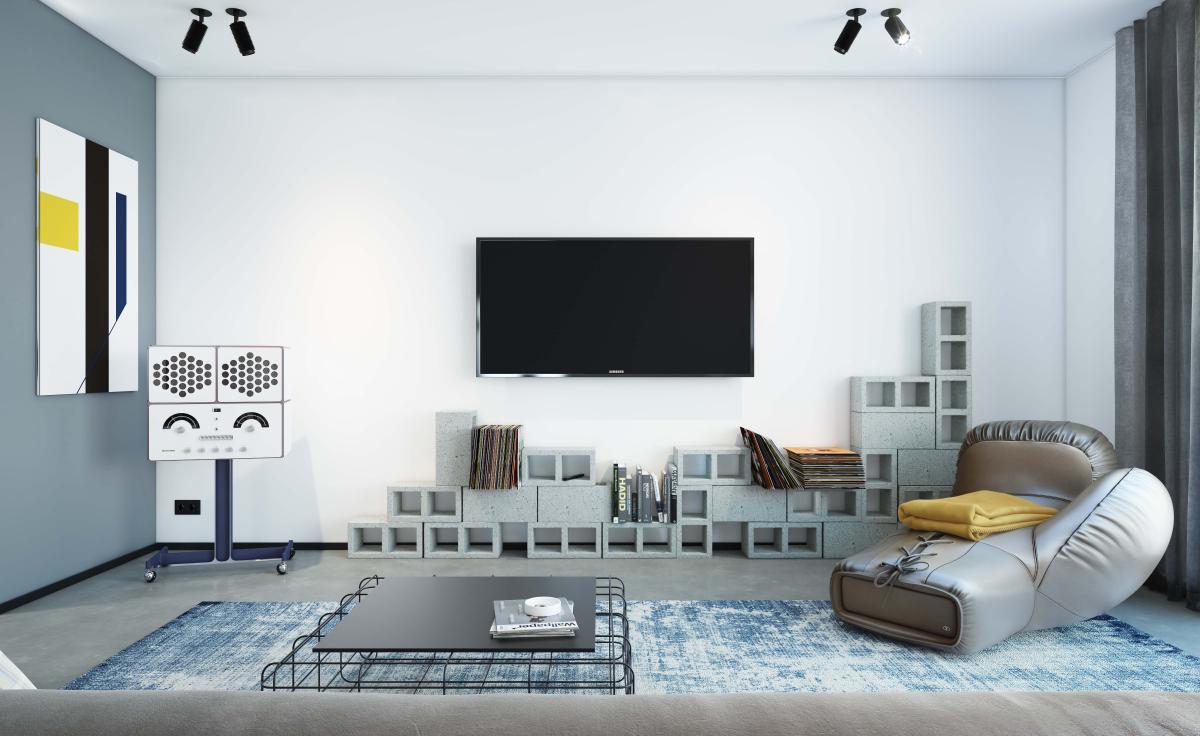 Combineer staalblauw met zwart en wit voor een opvallend kleurcontrast in de woonkamer