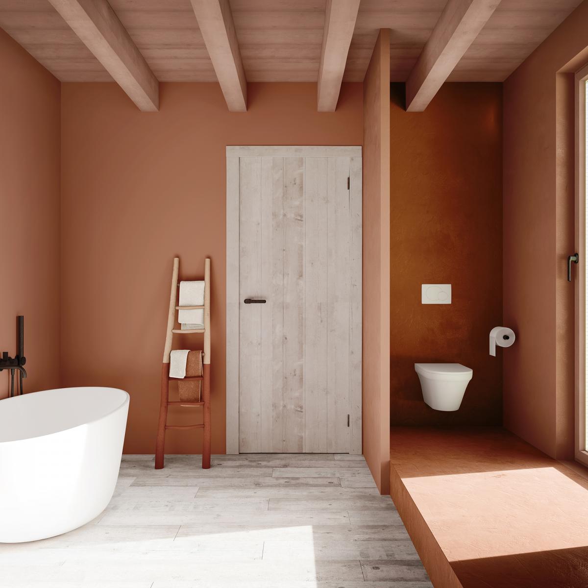 Creëer een intieme badkamer met warme verfkleuren