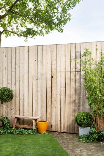De originele houtkleur van je tuinhek behouden