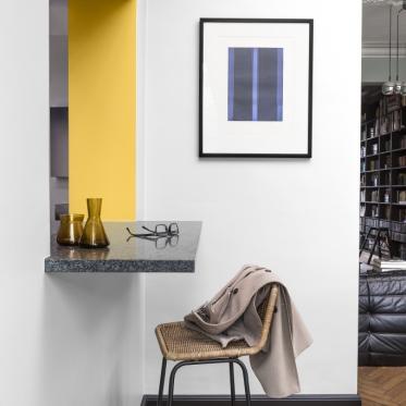 Schilder je muur in wit en geel